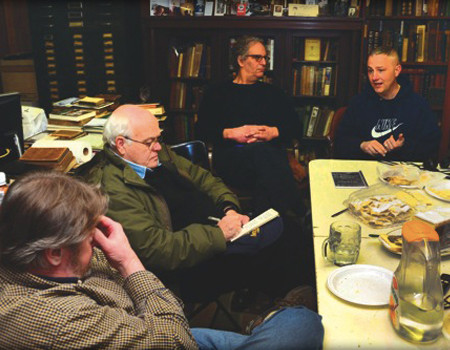 From left: Greg Gillespie, Irish Edition writer Frank Dougherty, book dealer Dave Miller, and paranormal investigator John Levy discuss the weird occurrences taking place at Port Richmond Books. — Photo  |  Jim Talone