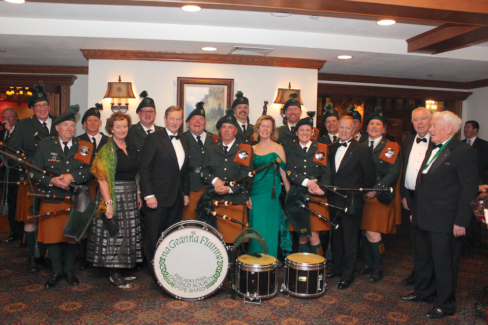 Consul General Barbara Jones; Taoiseach Enda Kenny; Irish Ambassador Anne Anderson; Friendly Sons President Joseph P. Heenan; Friendly Sons Past President Edward P. Last greet the Emerald Society Pipe Band