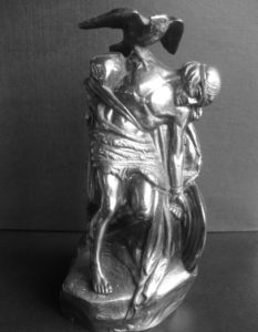 The Morrigan goddess in Irish art— Oliver Sheppards' statue of Cuchulain with the goddess Morrigan taking the shape of a raven and sitting on the shoulder of Cuchulain as he dies. The original statue is in the GPO Dublin and commemorates the 1916 Rising.